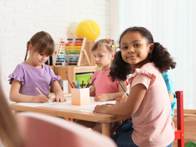 adorable children drawing together at table